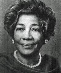 Dr. Angie Turner King, in a dark colored top and pearl necklace. The picture is in black-and-white.