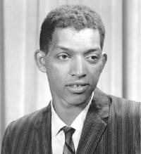 Black-and-white photograph of Dr. George Robert Carruthers. He is wearing a striped suit and tie.
